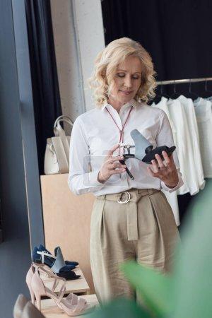 stylish woman choosing shoes