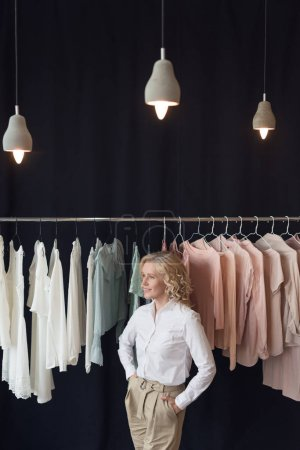 stylish woman in clothing store