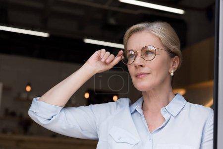 beautiful mature lady in eyeglasses