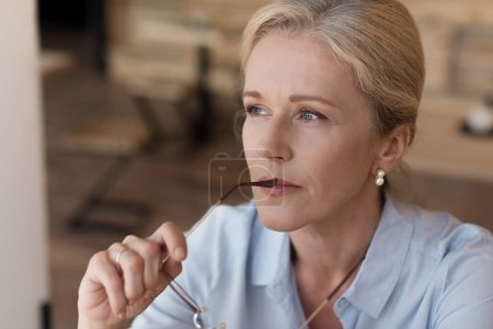 Mature woman with eyeglasses