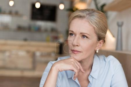 Photo for Portrait of beautiful pensive mature woman looking away - Royalty Free Image