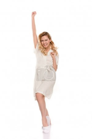 Photo for Cheerful young blonde woman in robe triumphing and smiling at camera isolated on white - Royalty Free Image