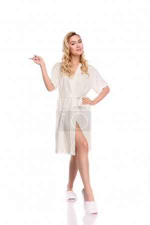 girl in robe pointing with finger