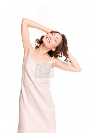 Photo for Beautiful happy asian girl with closed eyes posing isolated on white - Royalty Free Image