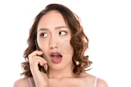 shocked girl talking on smartphone