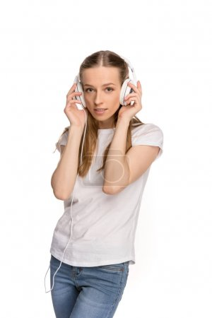 young woman in headphones