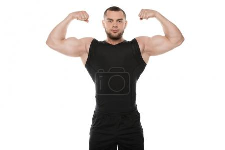 Photo for Athletic young man showing muscles and looking at camera isolated on white - Royalty Free Image