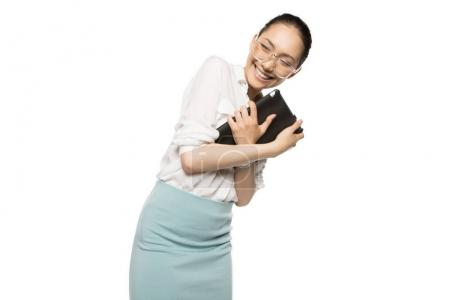 Photo for Smiling young asian businesswoman holding digital tablet isolated on white - Royalty Free Image
