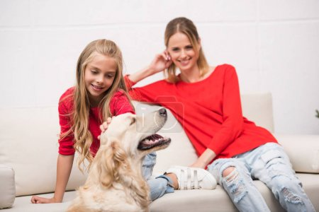Mother and daughter with dog