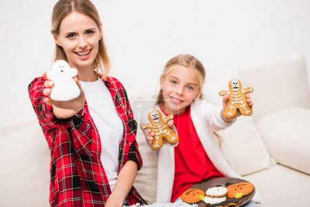 mother and daughter with halloween cookies