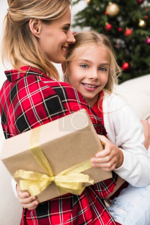 mother and daughter with christmas present