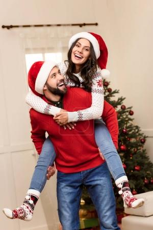 Happy couple in santa hats