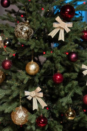 Photo for Close-up view of christmas tree with shiny baubles and decorations - Royalty Free Image