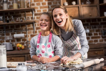 family having fun while cooking together