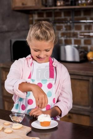 Kid making cupcake