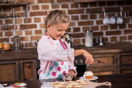 kid making cupcake