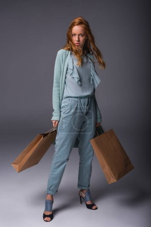 girl in blue with shopping bags