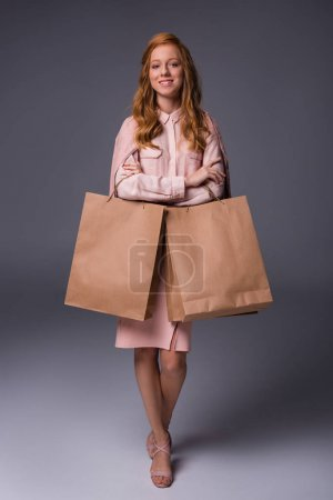 redhead lady with shopping bags