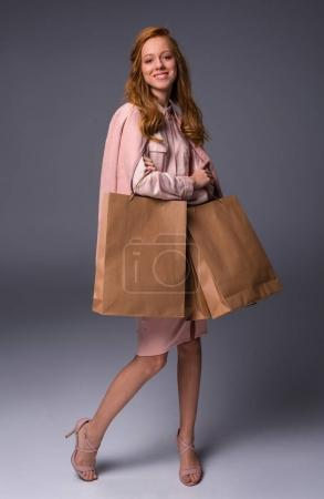 lady in pink with shopping bags