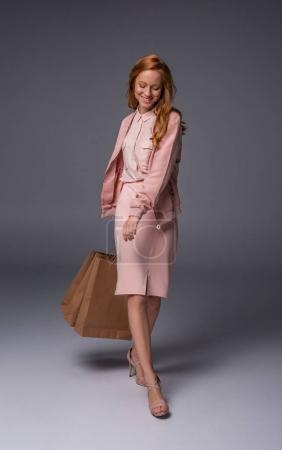 redhead girl with shopping bags