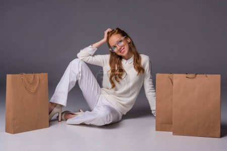 fashionable girl with shopping bags