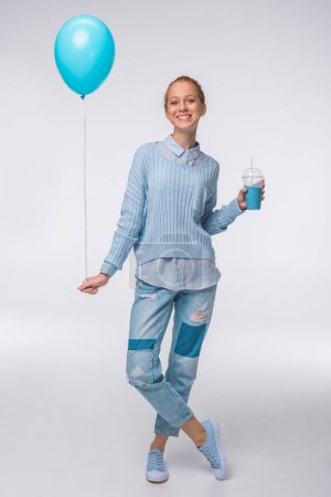 Girl with drink and balloon