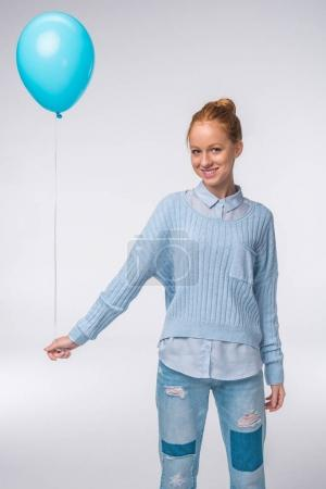 girl in blue clothes with balloon