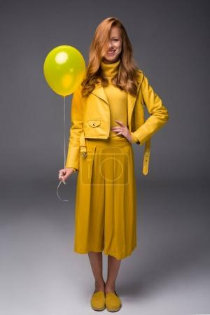 fashionable girl in yellow clothes