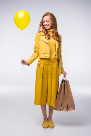 girl with shopping bags and balloon