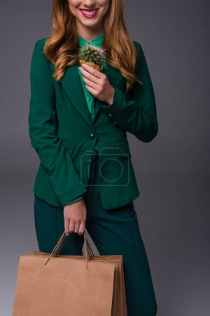 girl with cactus and shopping bags