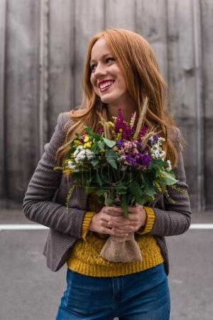 redhead girl with flowers
