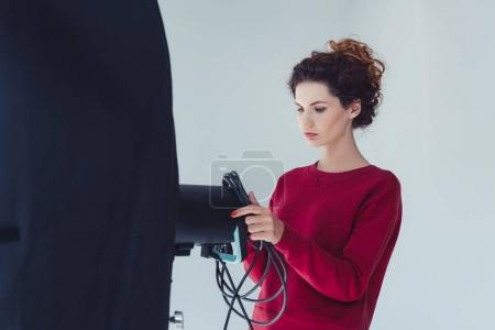 Photo for Professional female photographer with softbox in photo studio, isolated on grey - Royalty Free Image