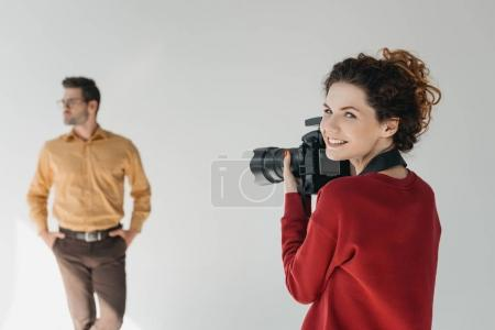 female photographer and stylish model