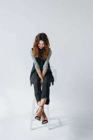 Photo for Attractive elegant model on fashion shoot in photo studio, on grey - Royalty Free Image
