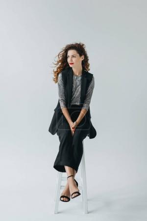 Photo for Beautiful stylish model on fashion shoot in photo studio, isolated on grey - Royalty Free Image