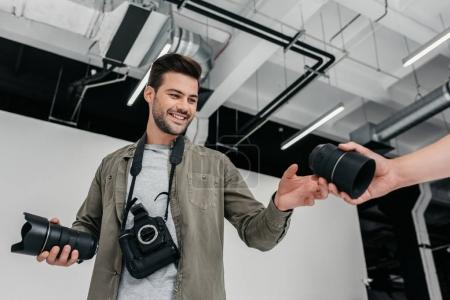 photographer with camera and lenses