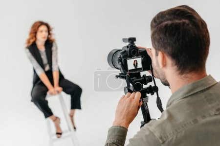 Photo for Professional photographer and beautiful model on fashion shoot in photo studio with lighting equipment - Royalty Free Image
