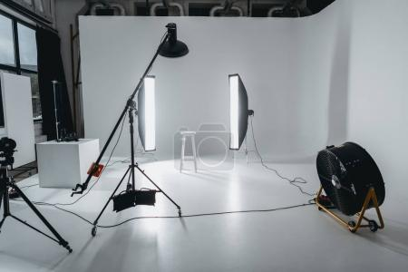 Photo for Photo studio with lighting equipment and fan - Royalty Free Image