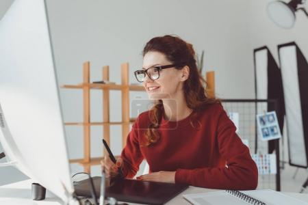 Photo for Female designer working with graphics tablet in modern office - Royalty Free Image