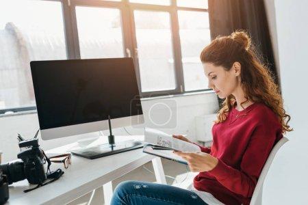 designer reading magazine