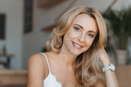 Photo for Portrait of beautiful happy middle aged woman smiling at camera - Royalty Free Image