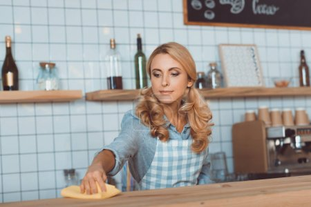 waitress cleaning bar counter