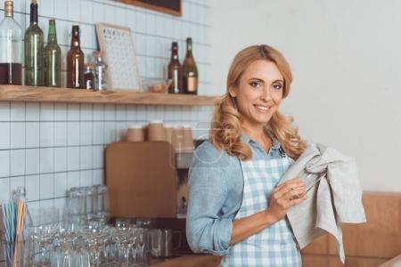 cafe worker cleaning utensil