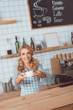 Waitress giving mug with coffee