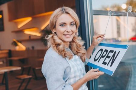 waitress with sign open
