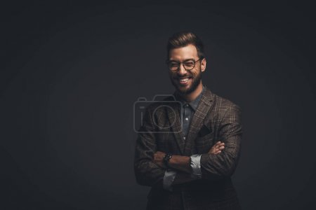 Laughing man with arms crossed