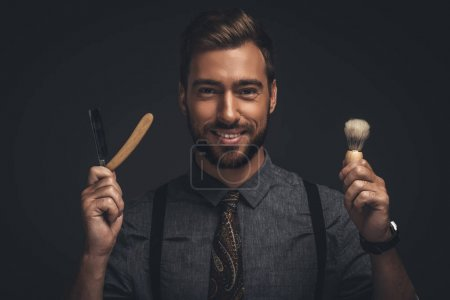 Man holding razor and brush