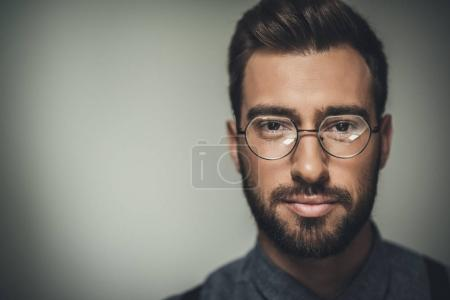 Photo for Portrait shot of young handsome man in glasses looking at camera - Royalty Free Image