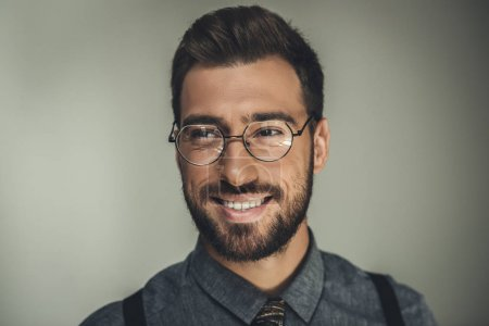 smiling man in glasses