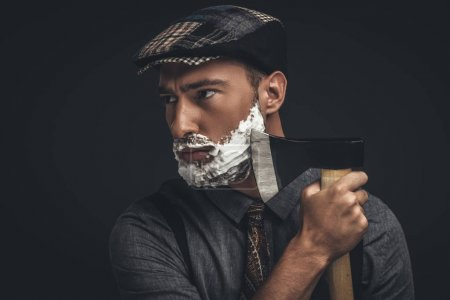man shaving with axe